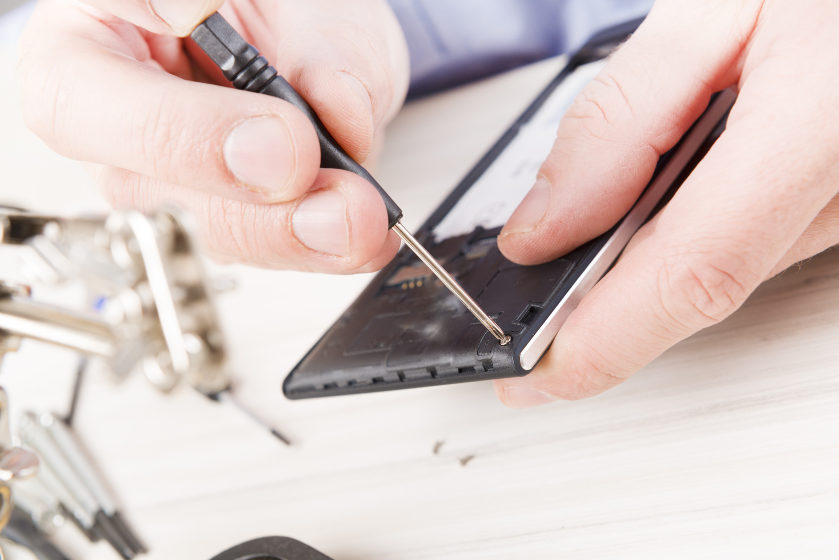 A man repairing mobile phone in the electronic workshop